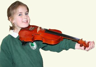 Child holding a violin to show the correct size of violin