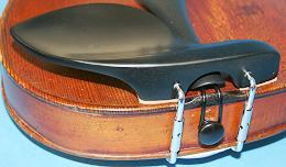 Good quality nicely finished Guarneri  styled chinrest in Ebony. Suitable for a full size violin and some 3/4 sized models. Comes complete with good quality chromium plated fitting hardware. A very popular design.