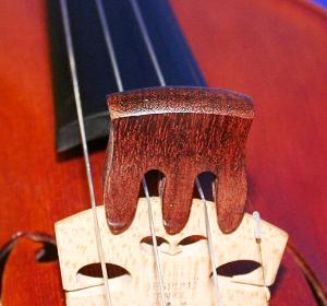 A nicely finished three legged curved mute carved from rosewood. Provides a substantial reduction in sound from the violin when fitted to the bridge.