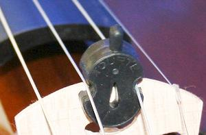 Tourte Shaped Rubber Mute. Clips onto the A and D string behind the bridge and rests by the tailpiece when not needed. Just slide it forward and clip it onto the bridge when you do need it.